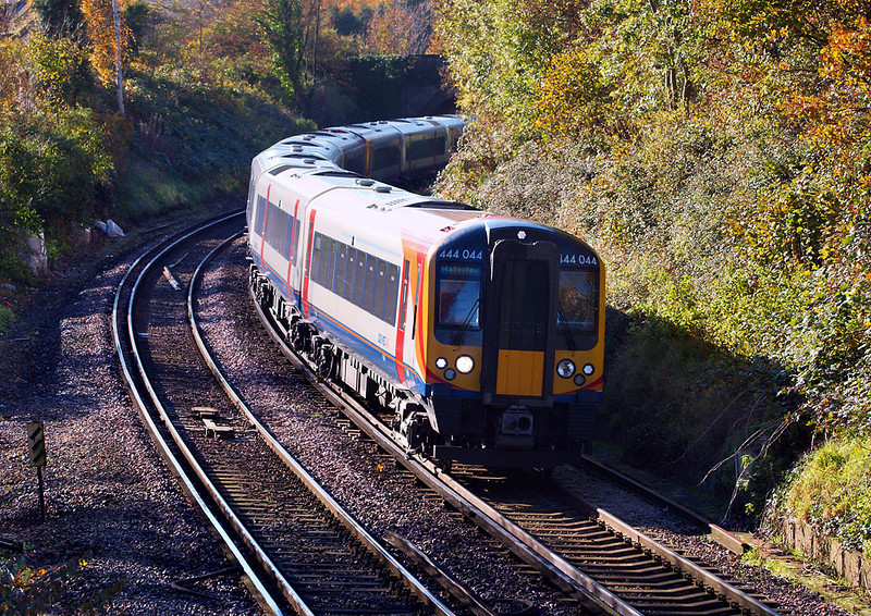 19th Nov 06:  444044 heading north and is on the reverse curves south of Farncombe station