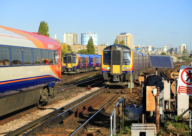 9th Nov 06:  Clapham is very busy and very cluttered. My objective was to photograph 450114.  442418 and 450042 had other ideas