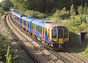 7th Oct 06:  73208 & 73136 wait while sleepers are unloaded between Wraysbury and Staines