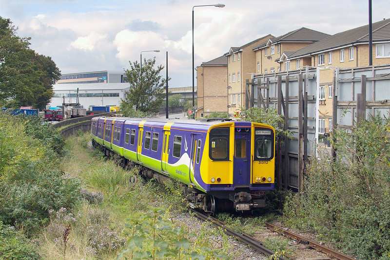 19th Oct 06:  313112 climbs out of the tunnel and through the undergrowth and into Silvertown