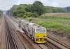 7th Oct 06:  Network Rail's DR98930 Water Cannon finds a gap in the traffic on the Down Main near Winchfield.  The right hand rail was not being cleaned.  11th