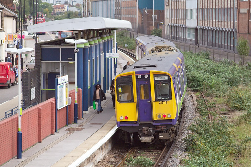 19th Oct 06:  A few passengers alight from 313112 at Silvertown