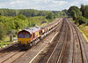 3rd Oct 06:  66064 slowly passes with enpty hoppers forming the 10.29 Hayes to East Usk