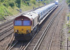 25th Aug 06:   66041 comes out of the sun from the Salisbury line with 6Z23 Transit vans to Bescot