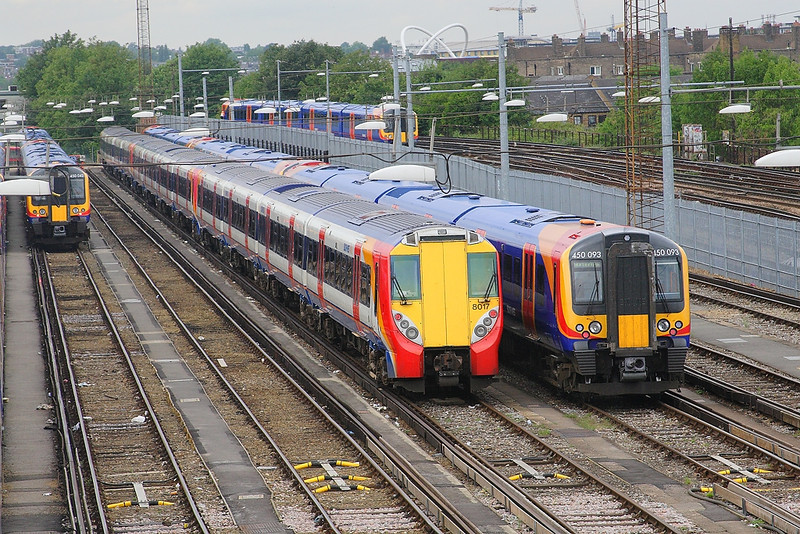 16th Aug 06:  450042,458017 & 450093 rest in the carriage sidings