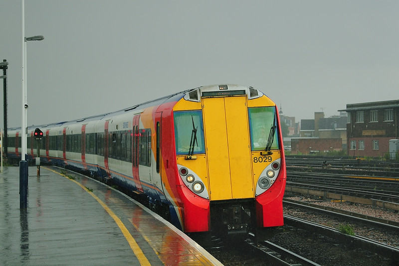 16th Aug 06:  My train home, 458029 enters Platform 6 during a torrential downpour