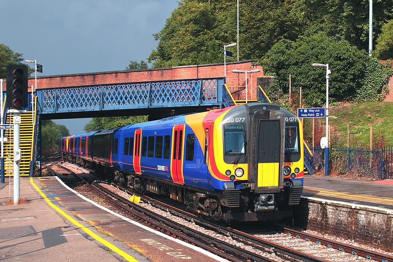 16th Aug 06:  450077 pauses with a Waterloo to Weybridge via. Hounslow service