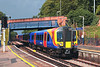 16th Aug 06:  450077 pauses with a Waterloo to Weybridge via. Hounslow service