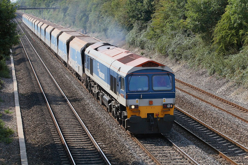 "11th Sep 06:  59104 ""Village of Great Elm"" plods up the Main at the regulation 45mph with 7A09 Merehead to Acton.  125mph trains use this line every few minutes and two such were pottering along behind running on Single Yellows !"
