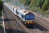 """11th Sep 06:  59104 """"Village of Great Elm"""" plods up the Main at the regulation 45mph with 7A09 Merehead to Acton.  125mph trains use this line every few minutes and two such were pottering along behind running on Single Yellows !"""