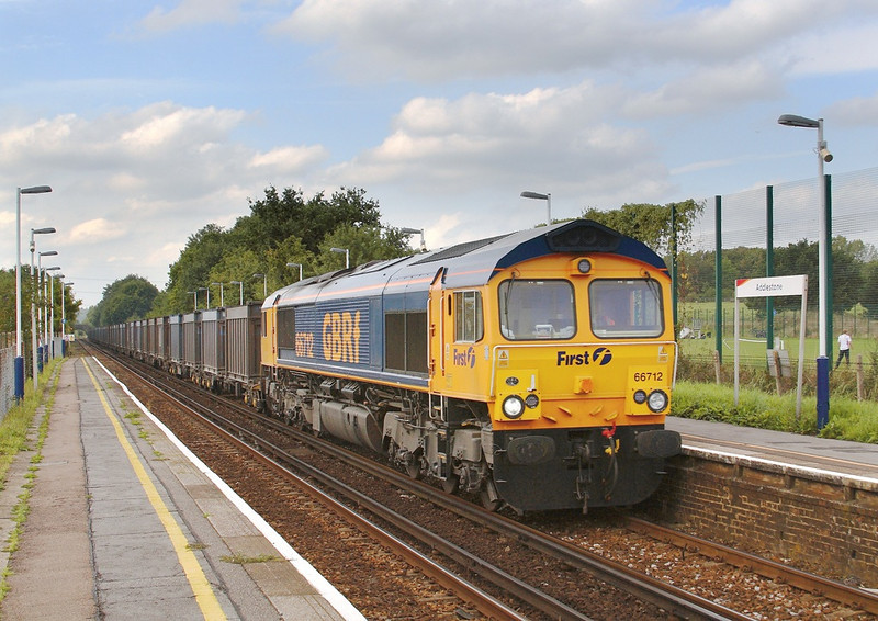 13th Sep 06:  66712 follows the Desiro and by now the sun is hiding behind a big black cloud.