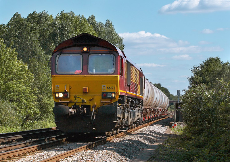 7th Sep 06:  With the tanks straddling the M3 motorway 66123 approaches Trumps Mill Lane in Virginia Water with 6M44 Eastleigh to Wembley Enterprise service