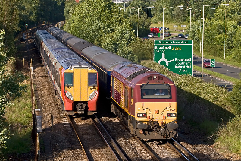 Juniper 458011 completely masks the 'North Briton' set as 67020 makes for Manchester.