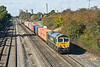9th Oct 08: 66568 has just passed the site of Moreton Cutting marshalling yard on it's way from Leeds