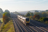 9th Oct 08:  In beautiful soft morning light 220027 nears the bridge at Manor Farm