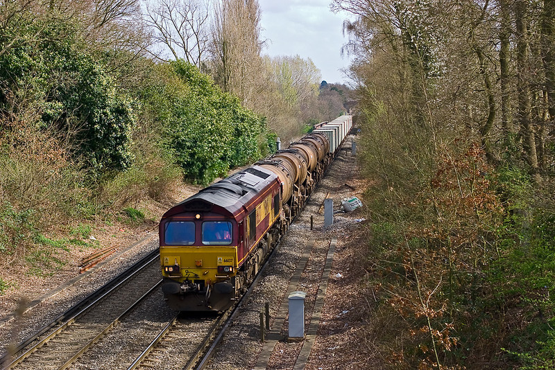 4th Apr 08:  The daily Eastleigh to Wembley Enterprise with Calcium Carbonate tanks on the front and powered by 66137 passes Trumps Mill Lane. Virginia Water