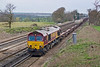 3rd Apr 08:  Running 1 hour late 66053 leads 6M44 Enterprise service from Eastleigh to Wembley passed Totters Lane nr. Winchfield