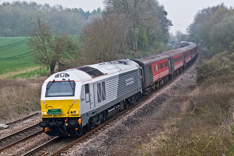 19th Apr 08:  67014 powers the returning 'Dorset Coast Express' tour through Silchester. Regrettably very dull and raining of course for my first sight of the new livery.