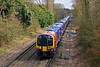 4th Apr 08:  The High Density pairing of 450553 and 450570 appoach Virginia Water on a Weybridge to Waterloo service