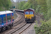 29th Apr 08:The afternoon Eastleigh to Hinksey Departmental in the hands of 66087 is passed by 165128 on a Basingstoke shuttle as it runs through Silchester.  Thanks driver for the toot!