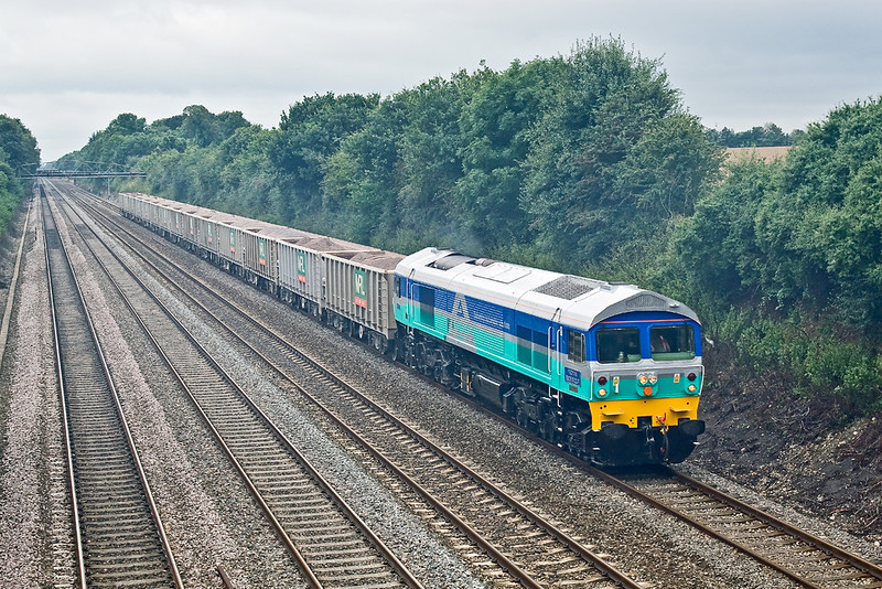 8th Aug 08: With smoke from a distant fire lying in the cutting 59001 powers 6A09 to Acton