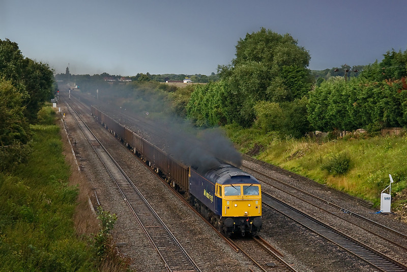 12th Aug 08:  Despite the little weak sun the ISO is up to 1600, 57005 clags west working 6Z56 Hitchin to Cardiff Tidal scrap metal