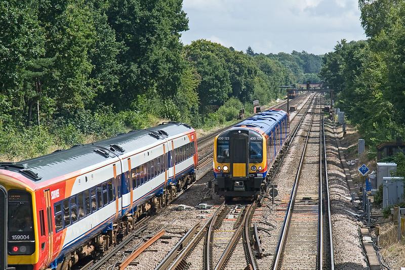 7th Aug 08:  450123 heads to Portsmouth Harbour and passes 159004 London bound