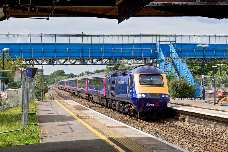 21st Aug 08: With the temporary foot bridge taking shape 43029 charges up the Main through Twyford