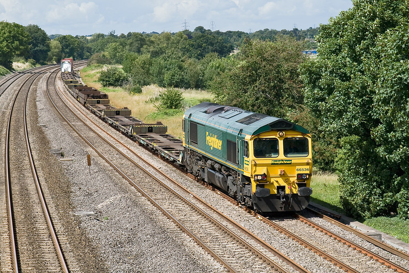 14th Aug 08: The 07.12 from Ditton is headed by 66536 and is on time as it passes the bridge at Lower Basildon