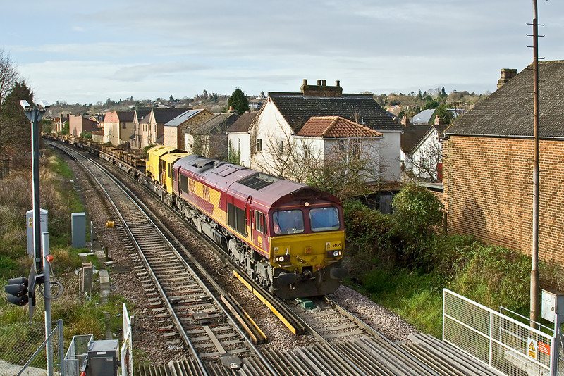 2nd Dec 08:  The morning Eastleigh to Hoo Junction departmental powered by 66135 arrives that the level crossing at Egham