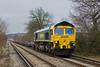 7th Feb 08:  Not the usual view as 66537 accelerated one box away from the severe restriction through Chertsey Station. 4O35 from Crewe is often lightly loaded.