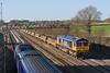 1st Feb 08: 66704 powers the Fairwater Yard (Taunton) to Peterborough Yard scrap sleepers at Milley Bridge- Waltham St Lawrence