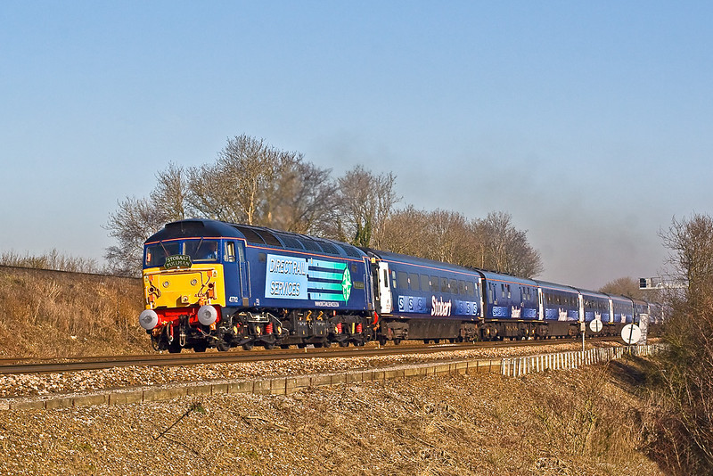 12th Feb 08:  Recently named 47712 'Pride of Carlisle' heads the 'Stobart Pullman' on it's inaugural run from Victoria - Fareham- Euston. Captured here about to pass under the flyover on the Salisbury line