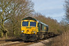 2nd Feb 08: The 01.35 Ditton to Southampton in the hands of 66567 rushes downhill and over the foot crossing at Mortimer