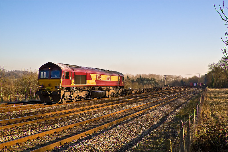 11th Feb 08: The lenthening shadows reach across the lines as 66141 passes with the 13.10 (4M36) to Birch Coppice