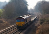 19th Feb 08:  66082 brings a very lightly loaded Marchwood to Didcot MoD 6V38 through Silchester