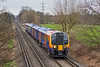 7th Feb 08:  Newly converted to High Capacity spec and renumbered from 450055 to 450555 crosses Addlestone Moor with the 15.03 from Weybridge