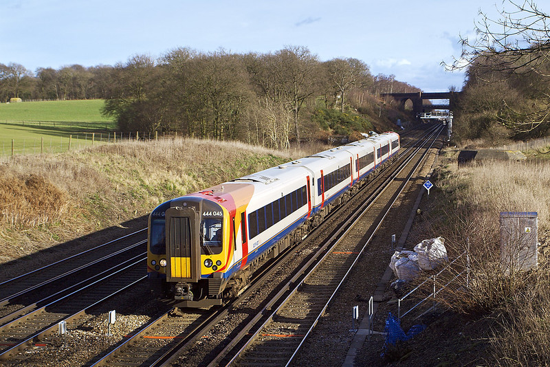 24th Jan 08: The wider view as 444045 makes for Weymouth.  The universal white sacks are well to the fore !