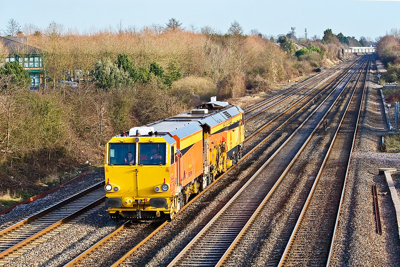 7th Jan 08:  A sparkling (new?) tamper in Colas livery heads west. Breadcroft Lane.