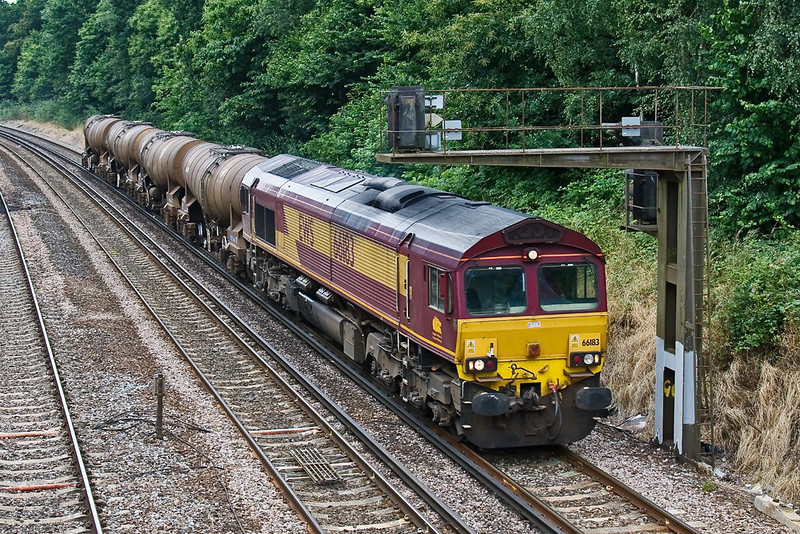 11th Jul 08: With only the Quidhampton Calcium Carbonate tanks 66183 leaves Farnborough working 6M44 from Eastleigh to Wembley