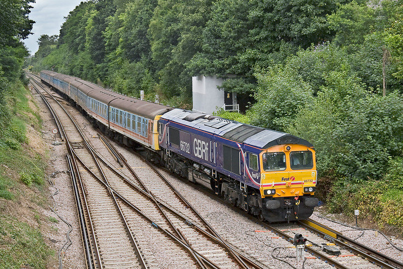 16th Jul 08: 66732 brings 4 Cig units 1881,1884 & 1304 onto the Chertsey line at Virginia Water.  They are being taken from Shoeburyness to Eastleigh