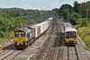 4th Jul 08: 66517 working 4M61 to Trafford Park is overtaken by 166218 on a fast to Oxford