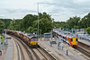 16th Jul 08:  66068 stands and waits for the road as 458013 departs from Virginia Water for Reading