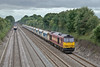 17th Jul 08: A class 60 and Hanson Hoppers is not unusual but when the starting point is in South Wales it is.  60075 working 6Z83 Machen to Acton passes Shottesbrooke.