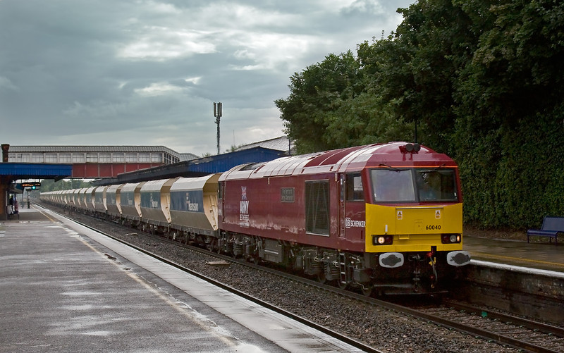 11th Jul 08:  At 4.30 pm and in the lull between two heavy storms 60040 drags 6A21 up the relief through Twyford.