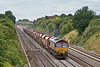 11th Jul 08:  66037 is seen from the bridge at Breadcroft Lane near Maidenhead as it travels along the 'Up Main' with 6M20 loaded stone from Whatley to St Pancras