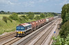 25th Jun 08:  With the Ex RMC rust buckets from Hothfield on the front 59102 brings 6V18 from Hither Green to Whatley through Shottesbrooke