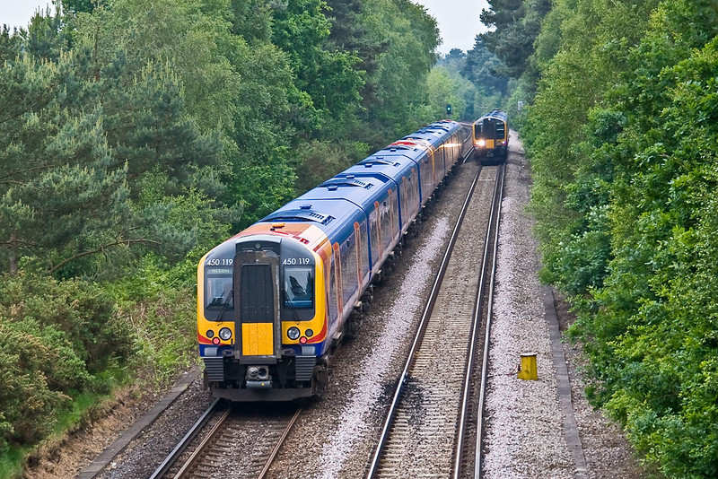 2nd Jun 08: 450119 tails the 12.53 Waterloo to Alton at Fox Hills.  450071 approaches.