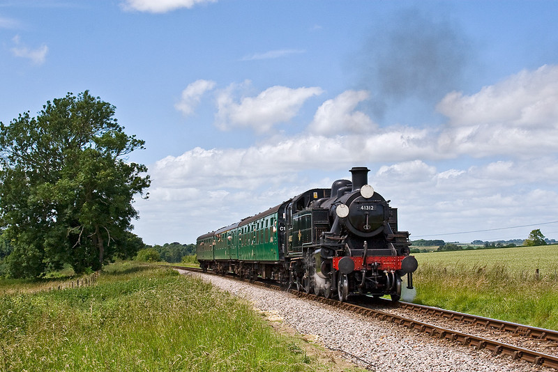 22nd Jun: Ivat tank 41312 climbs through Bishops Sutton with the 12.52 from Arlesford