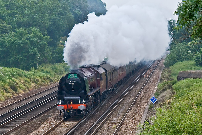 1st Jun 08: 6233 Duchess of Sutherland storms along the Down Main line away from Winchfield.  Heading to Exeter from Waterloo the 'Cathedrals Express'  will be diverted via Castle Cary from Yeovil.  G